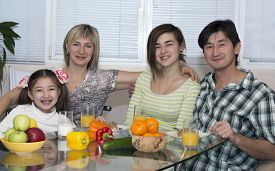 pic of breakfast  - Breakfast of multiethnic family Family of four people is having breakfast - JPG