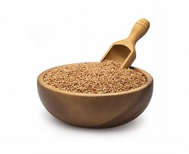 pic of buckwheat  - Buckwheat groats in a bowl and wooden scoop with buckwheat - JPG