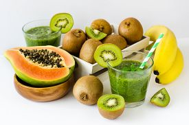 picture of papaya fruit  - Green healthy kiwi tropical fruits smoothie with papaya and bananas - JPG