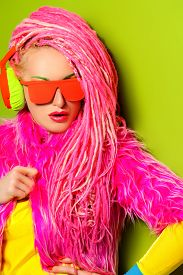 foto of dreadlock  - Modern party girl DJ in bright clothes - JPG