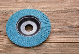 image of abrasion  - Abrasive wheels isolated on wooden background in studio - JPG