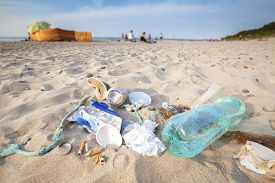 picture of polluted  - Garbage on a beach left by tourist environmental pollution concept picture Baltic Sea coast Poland - JPG