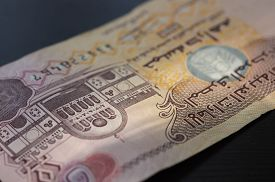 picture of dirham  - Banknote of the United Arab Emirates in five dirhams close up - JPG