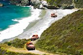 stock photo of beetle car  - Waves Crashing Beach Buggies on Sandy California Beach - JPG