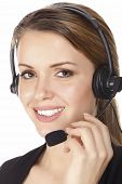 Beautiful customer service operator woman with headset, isolated on white background