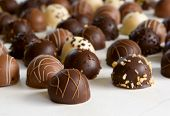 chocolate truffle background - focus on front truffle