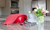 dinnertime - casserole, plates, flowers, in modern kitchen