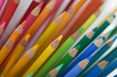 lots of colourful pencil crayons - background