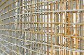 lattice of metal rebar rod reinforcement for concrete pouring at constructionsite