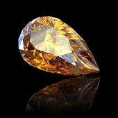 Pear. Citrine. Jewelry gems on black background