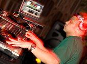 Dj in motion in nightclub