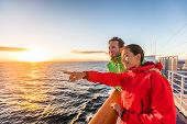 Cruise travel tourists couple pointing at sea view from ferry tour. Asian woman multiracial people t poster