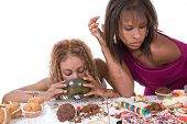 image of bulimic  - Two black girls in a horrible food binge - JPG