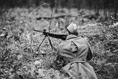 Re-enactor Dressed In Overcoat As World War Ii Russian Soviet Red Army Soldiers Hidden Aiming With M poster