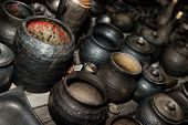 Burnt Black Ceramics. Burnt Clay Pots And Plates, Dishes - Image poster