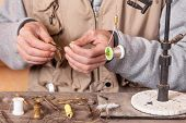 Man Making Trout Flies. Fly Tying Equipment And Material For Fly Fishing Preparation . poster