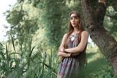 Beautiful Hippie Girl Standing Among Trees In Forest poster