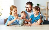Financial Planning Happy Family Mother Father And Children With Piggy Bank At Home poster