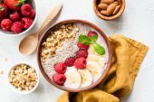 Acai Smoothie Bowl With Superfood. Fruit Smoothie With Banana, Raspberry, Chia Seed And Granola In C poster
