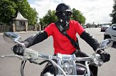stock photo of speculum  - Motorcyclist poses with mask and moto helmet - JPG