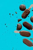 Chocolate Ice Lolly And French Macrons On Blue Background. Objects Without Of A Shadows poster
