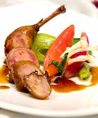 stock photo of lamb chops  - Lamb chops served with zucchini and peppers - JPG
