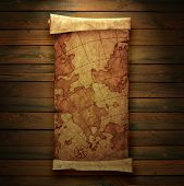 ancient scroll map, on a wooden background