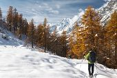 stock photo of winter scene  - Hiker in a winter mountain landscape Mont Blanc Italy - JPG