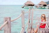 Little girl at terrace of over water bungalow