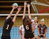 KAPOSVAR, HUNGARY - OCTOBER 14: Zsofia Harmath (in white) in action at the Hungarian I. League volleyball game Kaposvar (white) vs Nyiregyhaza (black), October 14, 2012 in Kaposvar, Hungary.