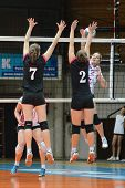 KAPOSVAR, HUNGARY - OCTOBER 14: Zsanett Pinter (in white) in action at the Hungarian I. League volle