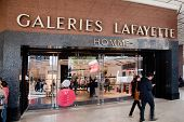 PARIS - OCT 2: Shoppers walk past the entrance to Lafayette shopping center on October 2, 2012 in Pa