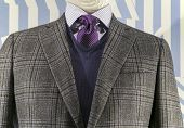 picture of v-neck collar  - Close up of a grey checkered jacket with blue v - JPG