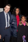 NEW YORK, NY - NOVEMBER 26: Direcror Benh Zeitlin, actress Quvenzhane Wallis  and guest attends the