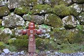 Red fire hydrant over the rock wall in nikko japan