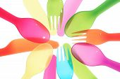Different Colors Spoon Knife And Fork Background Close