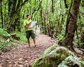 Man Hiker With Map In Forest