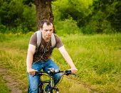 Young Man On The Gt Bicycle Biking Through A Sunny Countryside. Minsk, Belarus - June 14: Young Man