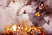 Witch Jumping Over The Fire
