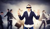 foto of struggle  - Image of businesswoman in blindfold walking among group of people - JPG