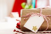 stock photo of gift wrapped  - Handmade present boxes with tags and twine cord ribbons - JPG