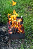 foto of brazier  - fire flames over burning wood in outdoor brazier - JPG