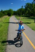 Small Boy On Bike Path