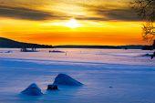 Golden Sunset On A Frozen Lake