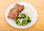 image of meatloaf  - Slices of home made meatloaf with mashed potatoes and broccoli - JPG