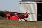 image of ultralight  - Small red airplane standing on an airfield - JPG