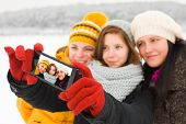 picture of selfie  - Group of pretty women together taking selfie with mobile phone.