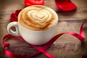 Valentine's Day Coffee with heart on foam. Heart drawing on cappuccino or latte art coffee. Love. Va