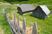 old fence and wooden hut in