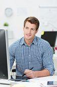 Handsome Businessman Working At His Desktop